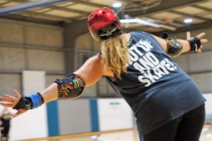 "Skater Kitty SlamHer in a ""Shut up and skate"" tank top"